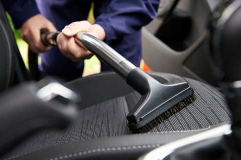 vacuuming a car